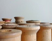 25 small vintage wooden spools
