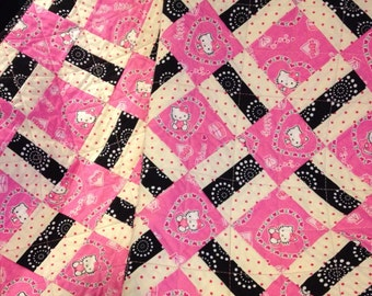 "Pink, Black, White and Hello Kitty Together In This Beautiful 40"" X 40"" Quilt"