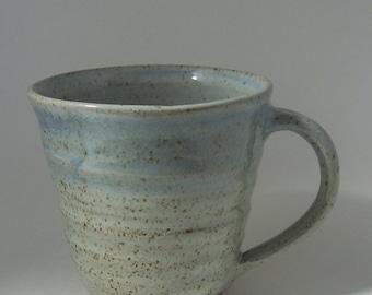 Stoneware coffee mug, tea cup. With speckled white glaze.