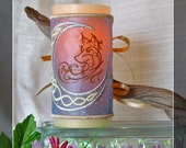 Soft Celtic Knots and a Silver Crescent Moon Cradle A Young Wolf on This Embroidered Candle Wrap For LED Flameless Pillar Candles.