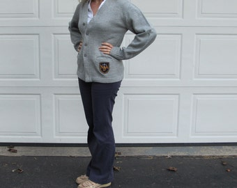 Catholic school girl sweater with school emblem