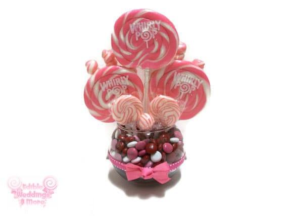 Small pink lollipop centerpiece wedding by edibleweddings