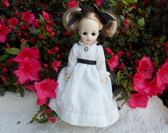 Ideal vintage doll made in 1982- eleven inch tall with Victorian dress and cameo so  lovely