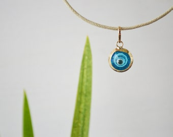 18K Gold Greek Evil Eye Pendant. Solid Yellow Gold. Blue Murano Eye. Beige Leather Cord with Silver Gold Plated Springring Clasp.