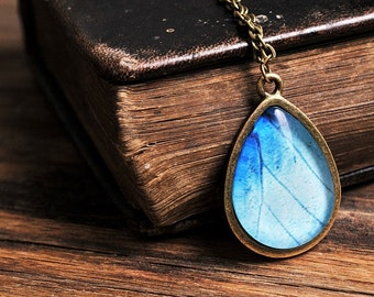 Butterfly wing necklace, antique brass necklace, tear drop necklace, tear drop pendant, glass necklace, blue necklace, butterfly necklace