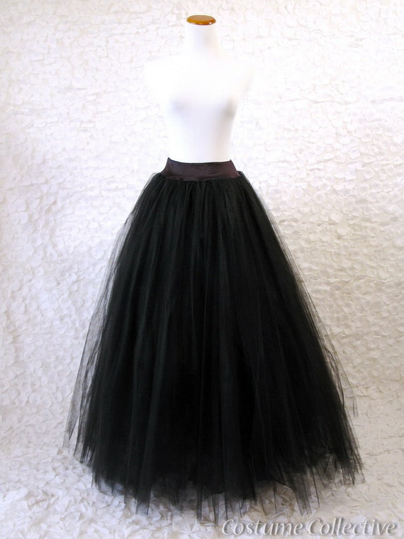 Long Black Tulle Bustle Skirt The slash-through price quote may reflect the price at which we previously sold the item, or in some instances, is based on a comparative analysis of the price of the same or a similar item being sold at retailers or online stores.