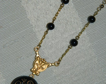 Handmade One of a Kind Necklace With Round Black and Gold Beads, Featuring a Tiny Black Button with a Swirly Gold Pattern