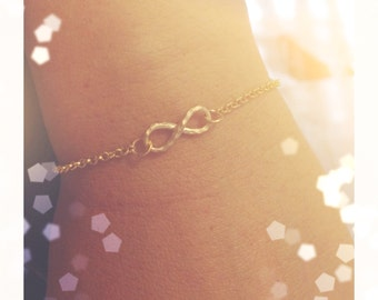 Silver bracelet with mini infinite gold and silver
