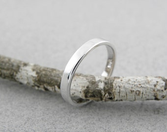 Wedding rings.2.5 x 1.5 mm.14k White gold wedding ring in shiny finish.Hand forged wedding rings.