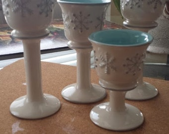 Set of 4 candle holders in various sizes