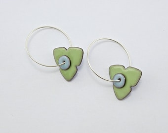 Reversible enamel trillium earrings; pastel green reverses to blue with light blue centers on sterling silver hoops