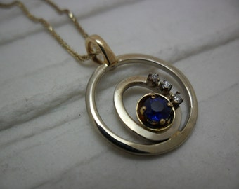14K Gold set with a sapphire and diamond pendant