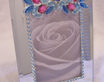 Beveled Mirror Photo Frame Designed with Vintage, New Jewelry and Rhinestones. Shades of Pink and Blue.