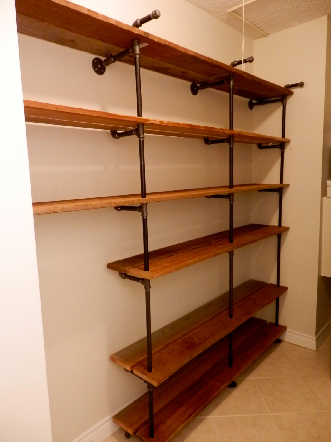 full wall shelves made with black iron pipe and by. Black Bedroom Furniture Sets. Home Design Ideas