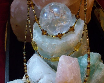 3 Strand glass bead necklace with fish beads as focal point.