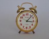 SALE Non-working Small Vintage Russian mechanical alarm clock by Slava. Red and Gold.