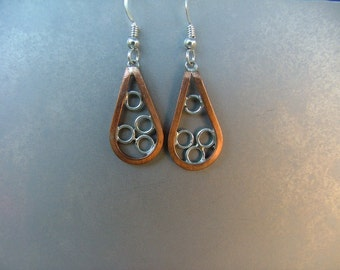 Teardrop earrings made of Copper and Sterling Silver.