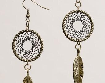 Earrings in shape of dreamcatcher