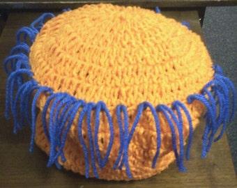 crocheted gator pom pom hat