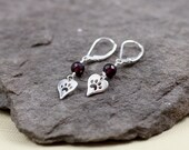 Sterling Silver Lever Back Earrings With Garnet And A Sterling Silver Heart With Paw Print