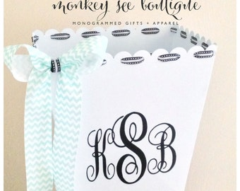 monogrammed trash bin with decorative accent ribbon