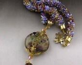 Beaded kumihimo necklace with handmade lampwork pendant