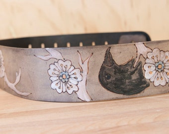 Leather Guitar Strap - Heather pattern with crow and flowers - white, black, light turquoise, light orange and antique black