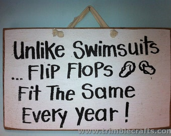 Unlike swimsuits flip flops fit the same every year sign wood handmade funny quote