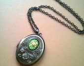 SALE Antique Brass Locket with Green Flower Cameo