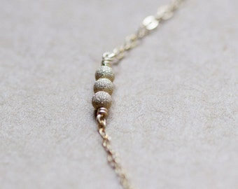"tiny gold bead necklace • ""stellar"" necklace in gold • dainty, light, modern • handmade by elephantine"
