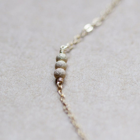 stellar in gold - tiny bead necklace by elephantine