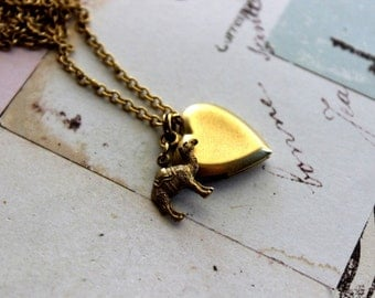 camel. heart locket necklace. gold ox