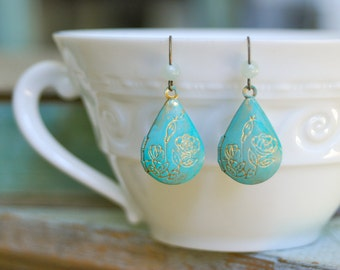 Libby. bohemian blue patina floral locket earrings.Tiedupmemories.