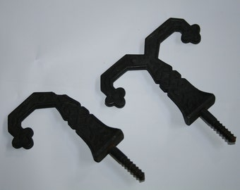 """old iron hooks  antique 3 1/2 by 3"""" you get two black iron screw them in"""