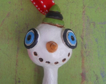Christmas Snowman Folk Art Ornament in Green white and blue