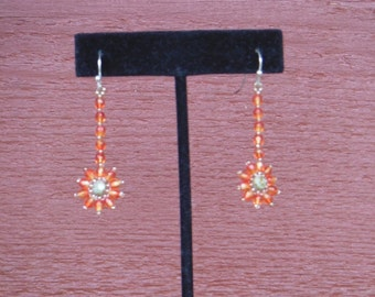 Orange flower drop earrings made with glass beads and crystals