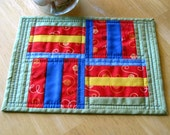 Mug rug in primary colors, 10 by 7 1/2, quilted