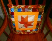 Quillow/Lap top throw with the colors of Autumn Orange