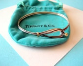 Tiffany & Co. Sterling Silver and 18K Gold Hook and Eye bangle