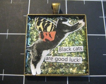 """Garden Faerie Cat Pendant: Black Tulip says """"Black Cats are Good Luck!"""", 50% goes to the current selected animal charity"""