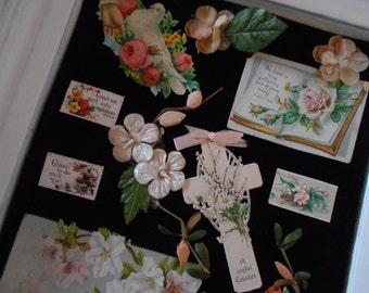 vintage framed victorian collage on fine black velvet, cream painted deep wood carved frame, pressed millinery flowers, scrap, satin ribbon
