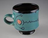 Blue,Green Porcelain Mug With Orange Spots And Unusual Black Linear Design