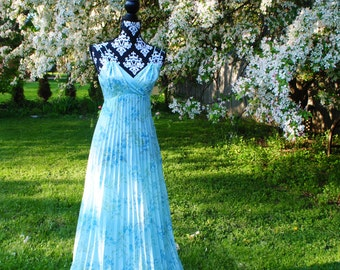Boho vintage 70s baby blue polyester  , accordion pleated maxi gown with a forget me not print and large capelet-scarf. size 6.
