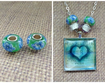 2pc...European Murano Glass Bead...Lt Blue Flower/Green..Great for Glass Tile necklaces. Fits most European Bracelets...B011