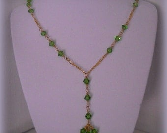 Green Crystal Wire wrapped Y Gold tone Necklace