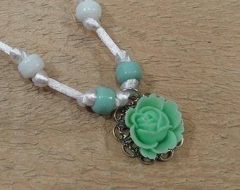 Rose necklace pastel green resin rose glass beads