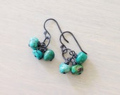 Naomi.  Turquoise and sterling silver earrings, antiqued silver earrings.