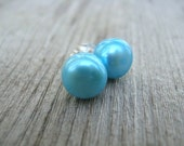 light turquoise pearl earrings in sterling silver. post earrings. pearl studs.