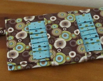 Retro Looking Fabric Clutch Bag in Brown and Teal