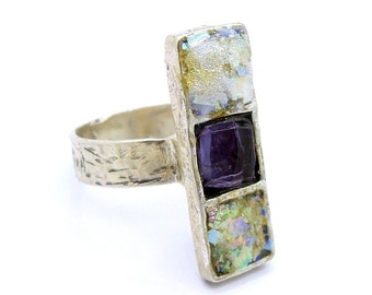 Gemstone ring with a purple zircon on sterling silver